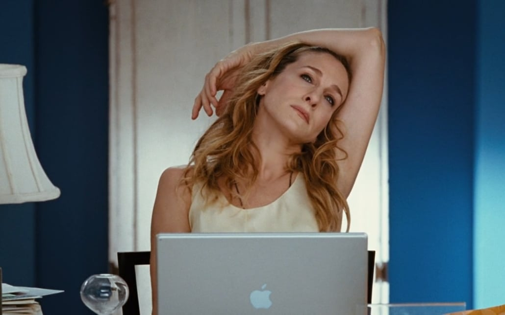 carrie bradshaw on her laptop writing